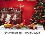 christmas dinner by candlelight ... | Shutterstock . vector #493501225