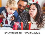 family blowing candles at... | Shutterstock . vector #493502221