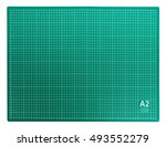 green cutting mat isolated on... | Shutterstock . vector #493552279