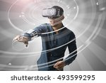 man using virtual reality... | Shutterstock . vector #493599295