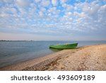Small Boat On The Beach On The...