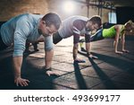 Group Of Adults Performing Pus...