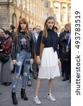 Small photo of PARIS - OCTOBER 5, 2016: Stylish European women at Vendome Square during Paris Fashion week. With Fashion week in New York, London and Milan, they are the four biggest fashion events in the world.