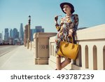 fashionable woman in a hat ... | Shutterstock . vector #493787239