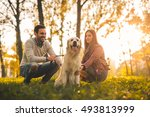 couple relaxing with their dog... | Shutterstock . vector #493813999