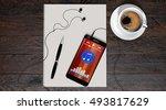 smartphone and earphones on...   Shutterstock . vector #493817629