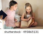 Two Little Girls Read A Book