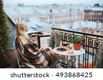 woman with tea sheltered... | Shutterstock . vector #493868425