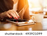 tablet close up photo with... | Shutterstock . vector #493921099