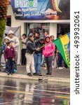 Small photo of Banos De Agua Santa, Ecuador - 23 June 2016: Group Of Families Waiting For The President Rafael Correa To entering In Banos De Agua Santa, Ecuador, South America