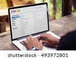opening inbox email on laptop | Shutterstock . vector #493972801