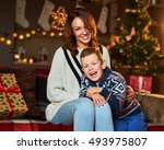 a loving mother with her baby... | Shutterstock . vector #493975807