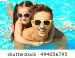 handsome father with little... | Shutterstock . vector #494056795