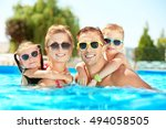 happy family in swimming pool... | Shutterstock . vector #494058505