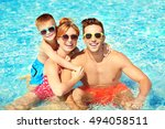 happy family in swimming pool... | Shutterstock . vector #494058511
