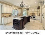 Stock photo kitchen in new construction home with double deck island 49406962