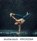 the male break dancer in water. | Shutterstock . vector #494142364