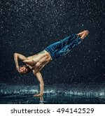 the male break dancer in water. | Shutterstock . vector #494142529