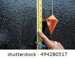 measuring level with plumb bob   Shutterstock . vector #494280517