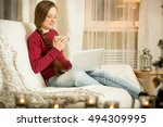 happy young woman in warm red... | Shutterstock . vector #494309995