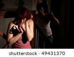 woman in room with abusive man | Shutterstock . vector #49431370