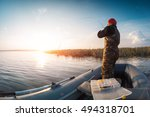 man fishing from the boat on... | Shutterstock . vector #494318701