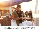 handsome man using cellphone on ... | Shutterstock . vector #494325517