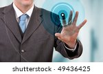 Businessman pressing touchscreen button - stock photo