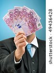Businessman with 500 euros banknotes handful, money loan from the bank, financial security, monthly salary, payment concept - stock photo
