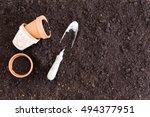 three small clay pots beside...   Shutterstock . vector #494377951