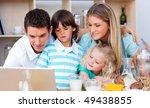lovely family using laptop... | Shutterstock . vector #49438855