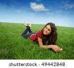 smiling young woman lying on a