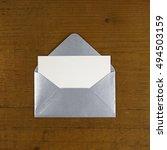 open silver envelope on wooden... | Shutterstock . vector #494503159