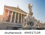 Small photo of Austrian parliament building with Athena statue on the front in Vienna, Austria. Beautiful travel picture with sunset light.