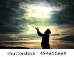 man standing prays for god in... | Shutterstock . vector #494650669