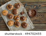 eclairs on wood background. | Shutterstock . vector #494702455
