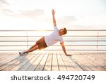 young fitness man doing yoga... | Shutterstock . vector #494720749