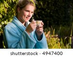 pretty blond woman enjoying a... | Shutterstock . vector #4947400