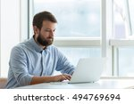businessman typing on laptop | Shutterstock . vector #494769694