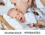 mother kisses her newborn son... | Shutterstock . vector #494864581