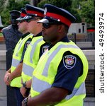 OTTAWA - AUG. 19: Ottawa police on duty at the protest of the Security and Prosperity Partnership talks in Ottawa, Canada on Aug. 19, 2007. - stock photo