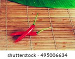 Two Red Chili Peppers On Bamboo ...