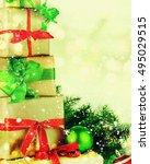 Stacks Of Christmas Presents O...