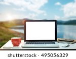 Side View Laptop And Coffee Cu...