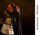 girl singing in concert on dark ... | Shutterstock . vector #4951564