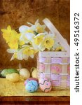 Photo based illustration of Easter eggs and daffodils. - stock photo