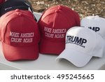 "Small photo of Asheville, North Carolina, USA: September 12, 2016: Colorful ball caps being sold at a Donald Trump campaign rally with the slogan ""Make America Great Again"" on September 12, 2016 in Asheville, NC"