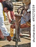Small photo of Mayapur, India, MARCH 12, 2016: indian man get water to drink in time of Gaura Purnima festival