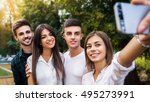 say cheese. four happy young... | Shutterstock . vector #495273991