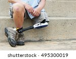 amputee with legs crossed ... | Shutterstock . vector #495300019